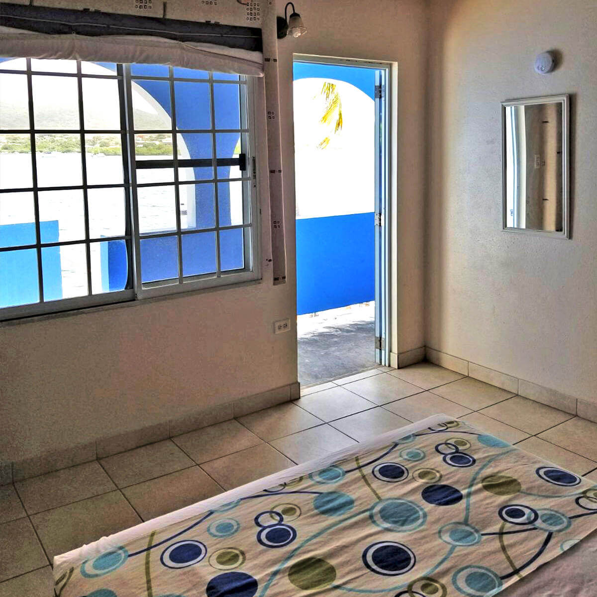 Villa Boheme Guest Room #9 - Doorway to private balcony.